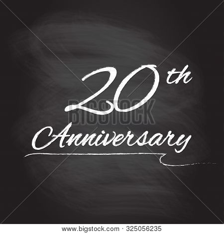 20th Anniversary Emblem Hand Drawn By Chalk. 20 Years Celebration Isolated On Blackboard Background.