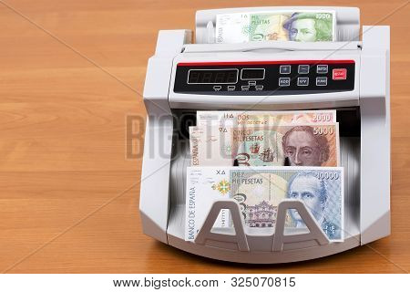 Old Spanish Peseta In A Counting Machine