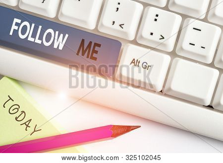 Writing note showing Follow Me. Business photo showcasing Inviting a demonstrating or group to obey your prefered leadership White pc keyboard with note paper above the white background. poster