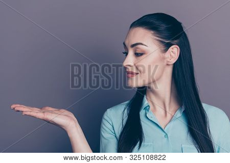 Close Up Photo Of Cheerful Atractive Business Lady Holding Ads With Her Hands Staring At Palm Wearin