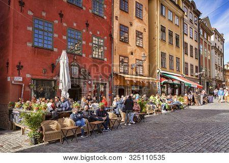 18 September 2018: Stockholm, Sweden - Tourists Enjoying The Sunshine Outside The Cafes And Restaura