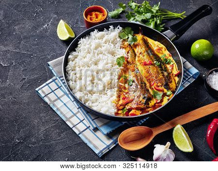 Close-up Of Fish Yellow Curry, Panang Curry With Grilled Saba Mackerel Fish Served With Steamed Long