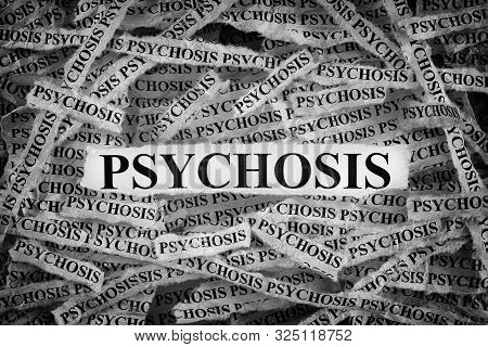 Psychosis. Torn Pieces Of Paper With The Word Psychosis. Concept Image. Black And White. Close Up.