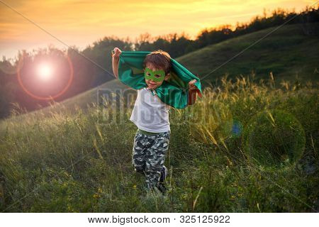 Little Boy Playing A Superhero. Kid In An Superheros Costume. Happy Child Runs To Meet The Photograp