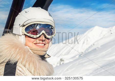 Portrait Of Young Adult Beautiful Happy Caucasian Woman Smiling On Ski-lift At Alpine Winter Skiing