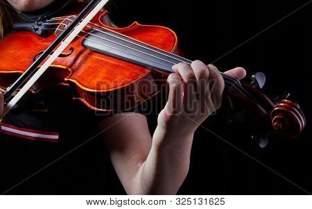 Violin Classic Musical Instrument. Classic Player Hands On A Black Background. Details Of Violin Pla