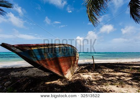 Wooden Boat Abandoned On The Beach