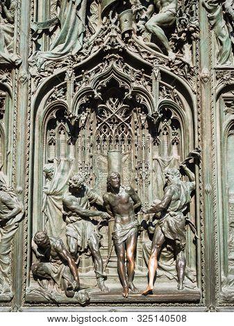 Ornate Detail Of The Bronze Door Of Milan Catehdral In Italy