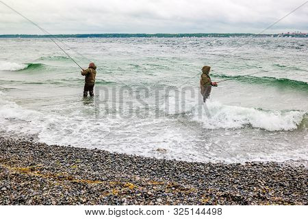 Helsingor, Denmark - May, 2019: People Fishing On Danish Shore Of Oresund, Outside The Kronborg Cast