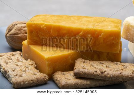Cheese Collection, Matured And Orange Original British Cheddar Cheese In Blocks Served On Grey Plate