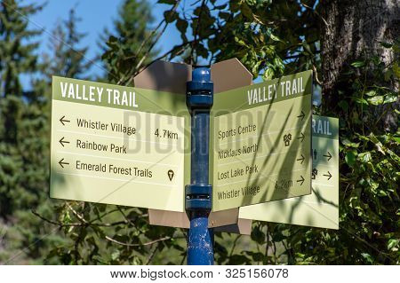 Valley Trail Crossroad Sign In Whistler, British Columbia, Canada In The Summer For Biking, Walking,