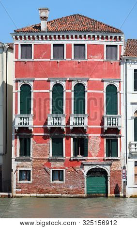 Ancient Red Palace In Venice In Italy Near The Navigable Canal