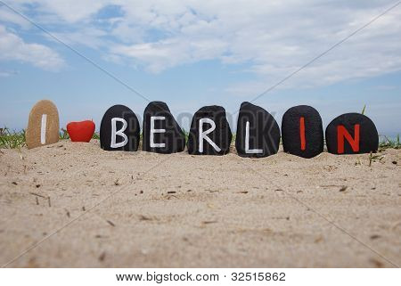 I love Berlin, stones composition on the sand
