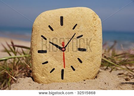 stone clock, game on the beach