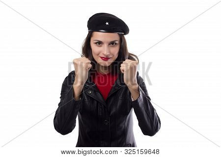 Young woman black jacket, red sweater and hat with a reference to revolutionary enthusiasm looking in camera, demonstrate her fists and smile on a white background poster