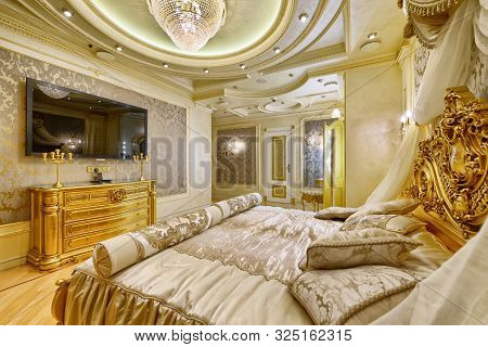 Luxurious Interiors In A Modern House.stylish Bedroom Interior With Double Bed.