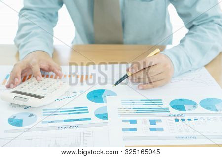 Business Man Using Calculator Working At Office With Reports Document Financial