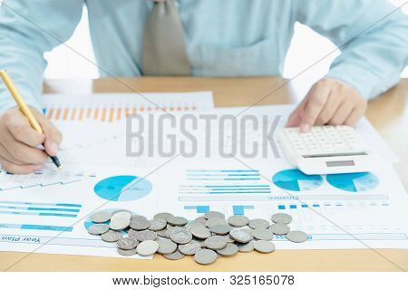 Businessman Hand Using Calculator And Reports Document Financial Counting Making