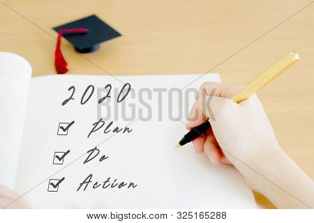 Woman Writing On Paper Finance Concept Plan
