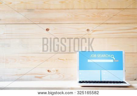 Online Job Search Engine On Laptop  On Wood Table
