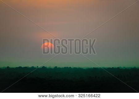 Mystic Sunset Scene Of Tropical Forest Dim Orange Sun Green Dusk Natural Spooky