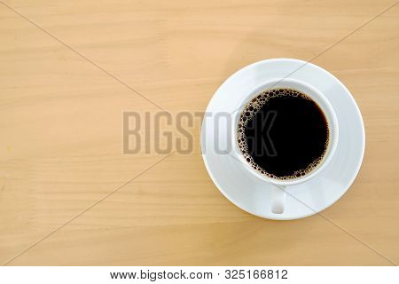 A Coffee On A Distressed Wooden Table