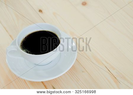 Black Coffee Cup On Table Wood Background