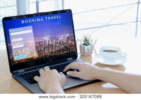 Man Using A Laptop For Booking Hotel Online. Tour Reservation