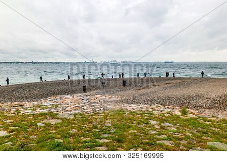 People Fishing On Danish Shore Of Oresund, Outside The Kronborg Castle. View Of Swedish Coast And Sc