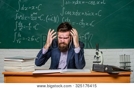 Annoyed And Irritated. Annoyed Man Gestures And Shouts In Anger. Annoyed Teacher Checks Examination