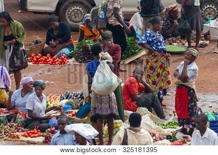 Kampala, Uganda - October 03, 2012.  Vendors Sell Their Vegetables At The Taxi Park In Kampala, Ugan