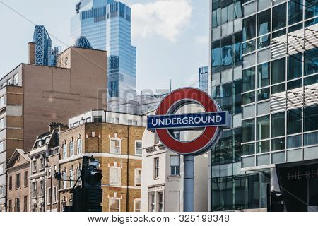 London, Uk - September 07, 2019: London Underground Sign Against Houses And Modern Office Buildings.