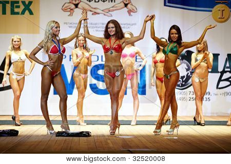 MOSCOW - APR 16: V.Komoza, O.Tsariova, A.Kolosova (in front) - winners in bikini category at the Open Championship and Cup of Moscow of bodybuilding, fitness, bodyfitness, Apr 16, 2011, Moscow, Russia