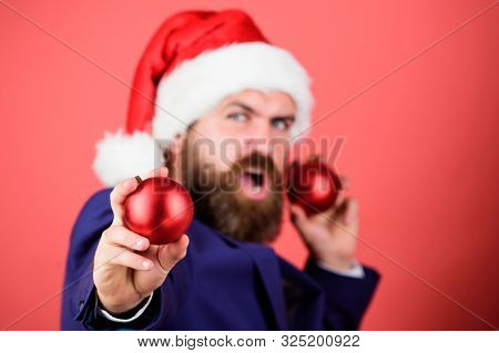 Man With Beard Hold Red Balls Christmas Decorations. Winter Holidays. Share Christmas Mood. Spread M
