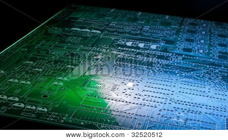 Printed circuit board close up,with blue and green lighting poster