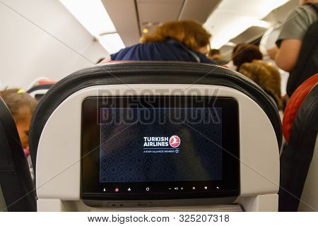 Turkey, Istanbul - September 9th, 2019: Screen With Logo On Back Of Seat On Airplane