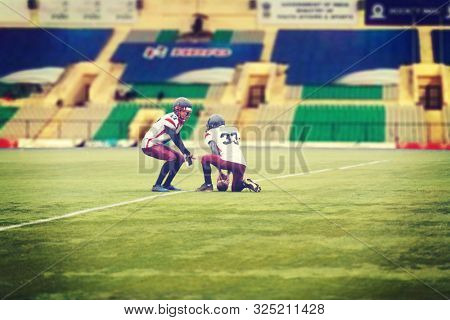 young professional american football players practicing football kickoff during training on the stadium field