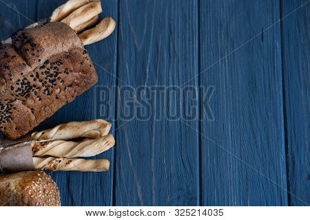 Background For A Bakery, A Department For The Sale Of Bakery Products. Photo Of Bread And Bread Stic