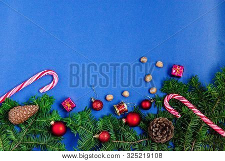Bright Christmas Or New Year Blue Background With Fir Branches, Christmas Caramels, Christmas Decora