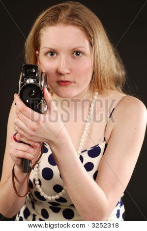 Girl Holding A Vintage Movie Camera