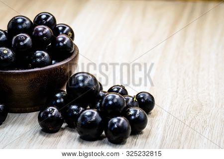 Fruit Called Jaboticaba Or Jabuticaba In A Basket On A White Background, Preserves Organic And Healt