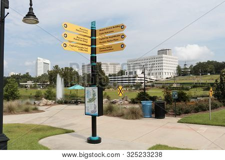 Tallahassee, Fl, Usa - July 15, 2018: Four-way Directional Sign Each Point To 12 Local Locations. Su