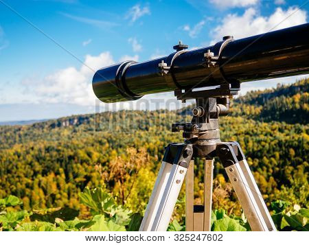 Observation Telescope With An Overview Of The High Mountains With Autumn Trees. Beautiful View Throu