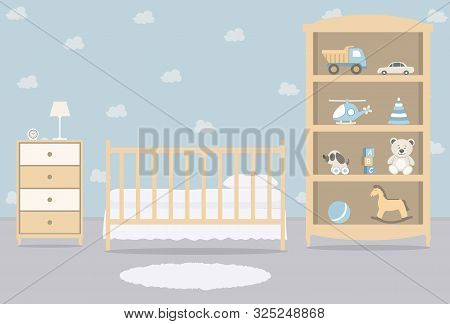 Kid's Room For A Newborn Baby. Interior Bedroom For A Baby Boy. There Is A Cot, A Wardrobe With Toys