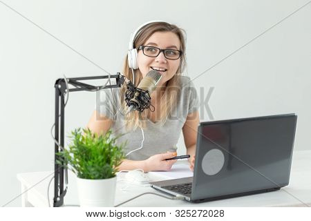 Radio Host Concept - Young Woman Working As Radio Host At Radio Station