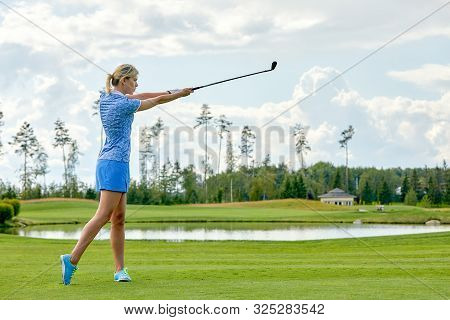Goal Concept, Copy Space. Women Golfing Time Holding Golf Equipment On Green Field Background. The P