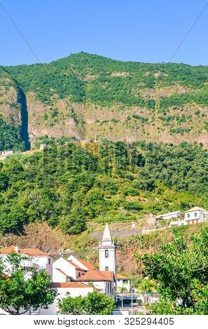 Beautiful Mountain Village Sao Vicente In Madeira, Portugal. The Small Town Is Surrounded By Steep G