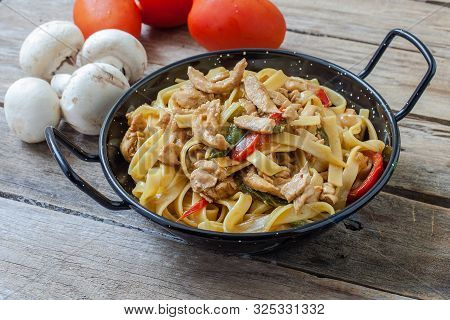 Chinese Noodles With Chicken And Veggies On Pot