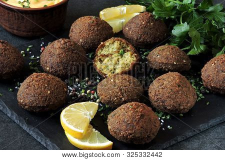 Fresh Falafel Balls, Spices, Sauce And Herbs. Vegan Falafel. Healthy Lean Food. Middle Eastern Cuisi
