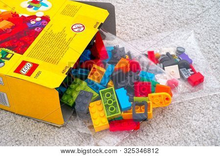 Tambov, Russian Federation - September 07, 2019 Lego Blocks And Bricks In Bags Spill Out Of Lego Box